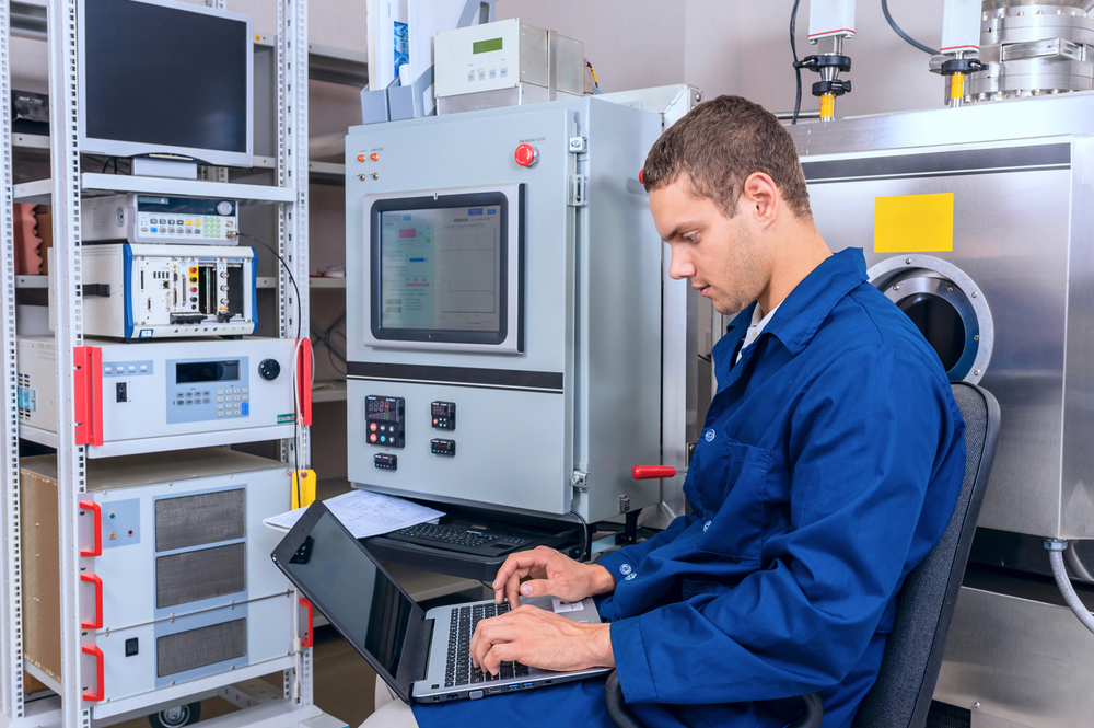 Young engineer working with a laptop working in a scientific laboratory